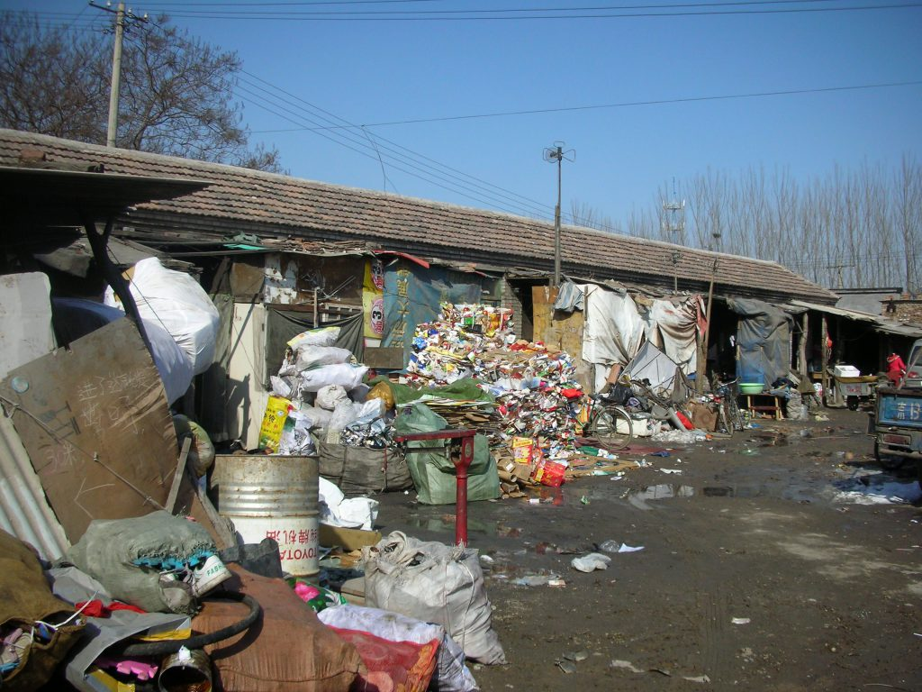 """Recyclables piled up in a """"waste courtyard"""" in Beijing. Photos courtesy Ka-ming Wu and Jieying Zhang."""
